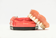 Dentures are more secure when they snap into dental implants