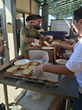 Mike Abramowitz hands out sandwiches