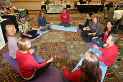 BGV employees enjoy some yoga exercises at the 2015 Wellness Fair in Breckenridge.