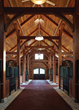 Timber abounds in this preeminent private equestrian farm, part of a complex of family homes and outbuildings. Photo by Tim Williams Photography, Inc.