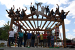 Volunteers celebrate a successful timber frame hand raising of the Granary District Stage Amphitheater in McMinnville, Oregon.