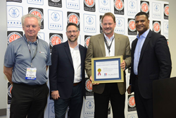 ROUSH Performance's Paul Grant, Tony Marszalek and Tim Wheeler accept the Export Achievement Certificate from Commerce Department Assistant Secretary Marcus Jadotte.