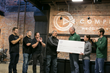 The Complete team giving a check for $24k to Global Partners in Hope
