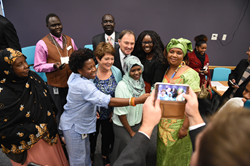 Governor Gary Herbert and First Lady Jeanette Herbert pause for a group shot Tuesday at the Utah Refugee Education and Training Center on Salt Lake Community College's Meadowbrook Campus.