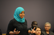 SLCC student and refugee Zakiya Ali tells her story to Utah Governor Gary Herbert at the Utah Refugee Education and Training Center on Salt Lake Community College's Meadowbrook Campus.