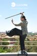 GuideWeTravel Tour Guide Practices Her Swordplay at JingShan Park, Overlooking The Forbidden City - Beijing