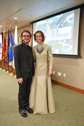 "Salt Lake Community College Fashion Institute student Charlie Fratto designed the gown shown here for Air Force Senior Airman Amanda Turner as part of the ""Grit To Glamour: Warrior To Woman"" fashion show."