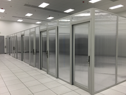 Colocation Suites are custom built onsite to add privacy, aid bypass airflow control, and improve aethetics