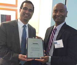 Altruista Health CEO Ashish Kachru (L) and President Ashish Abraham, MD, accept 2015 Deloitte Technology Fast 500 Award