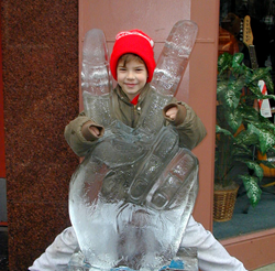 A boy poses with an ice sculpture at IceFest, the annual event which will be Jan 28 through Jan 31 this year!