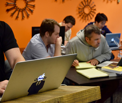 Students learning Javascript at DigitalCrafts, a boutique coding bootcamp in Atlanta, GA.