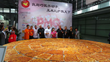 Groupon United States Pizza Team Members and Chinese competitors with The Largest Pizza in China