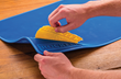 The Silicone Project Mat sheds dried glue simply by cracking it and peeling it off.