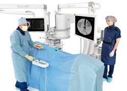 Vascular Surgeon Using NuCART and C Arm