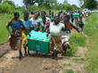 A group of women in Malawi carries a complete ShelterBox