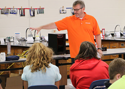 Brian Hedges, Training Manager at Balluff, spends the day teaching about sensors to students at Scott County Middle School.
