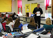 Joe Poehlmann, Technical Trainer at Balluff with students at Scott County Middle School.