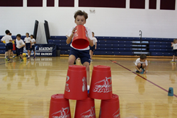Rosarian-Academy-student-Nicholas-Stewart-participates-in-a-Speed-Stacking-relay