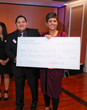 Guiillermo Chavez-Angeles donates $1000 to the Latino Summit, accepted by Harper College Recruiting Specialist and Latino Summit Event organizer Juanita Bassler.