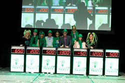 Cruise Planners always likes to do it differently and the 2015 cruise line executive panel includes top leaders playing a game show while showing their Cruise Planners green to an audience of more than 600 travel advisors. (L to R): Cruise Planners CEO an