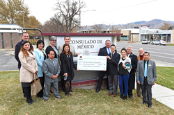 Mexican Consul Edwardo Arnal (left, holding check) poses with Salt Lake Community College staff and students at the Mexican Consulate in Salt Lake City.