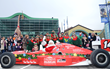 Santa Races into The Children's Museum of Indianapolis each year in a real IndyCar