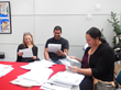Volunteers reading children's letters at the participating Los Angeles post office