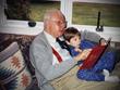 This picture of Walt's father reading to his son inspired LuvYa Reader