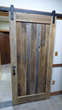 This Flat Track Door is grey and brown barn wood with black low profile hangers. It is Door Style B with v-groove panel planks and will find its way into a NY home soon.