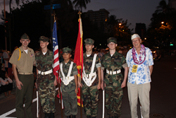 Young Marines lead the Pearl Harbor Memorial Parade in Honolulu with Mr. Tom Berg, a Pearl Harbor survivor who was 19 years old in 1941.