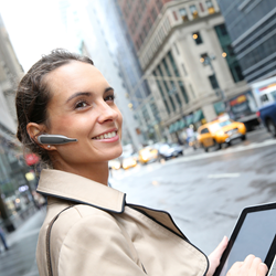Woman in the city wearing a BlueParrott Point headset