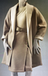 An Oscar de la Renta wool suit and cashmere sweater with gathered shoulder detail and belt is one of the pieces from the WRJ-designed exhibition that Mrs. Reagan wore while in the White House.