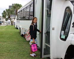 Rosarian-Academy-student-Sofia-Mendez-boards-a-Rosarian-bus