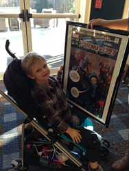 Trey admires his movie poster with Spider-Man