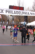 Author & filmmaker Ross Schriftman crosses the finish line of the Philadelphia Marathon