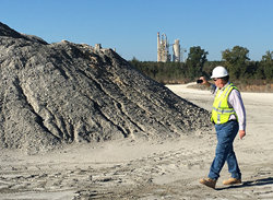 A quarry manager measuring a stockpile using a mobile device.