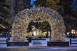 Jackson, Wyoming's Town Square, framed by elk antler arches, is beautifully lit throughout the winter and serves as the venue for WinterFest public ice skating.