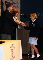 Rosarian-Academy-student-Blair-Haft-(6th-Grade)-accepts-award-from-Steve-Rubenacker