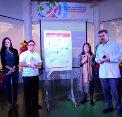 Leaders from CARD MRI, Freedom from Hunger, and the Microcredit Summit Campaign sign the Commitment wall