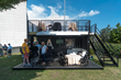 Ikoniq Designs Shipping Container Entertainment Venue for Tailgating and Game Action for West Point Football
