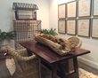 WRJ Design's new WRJ Rustic showroom in Jackson, Wyoming, highlights such special individual pieces as an Asian antique trough and a vintage Philadelphia bird house.