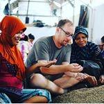 Crimson Cup Coffee Buyer Dave Eldridge (Center) examines Sumatran coffee beans