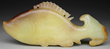 MOTTLED YELLOWISH JADE CARVING OF A CARP