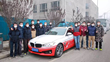 Baidu team gathers around autonomous vehicle, a modified BMW 3 Series