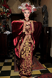 SUE WONG Model poised in front of Sue Wong's Klimt-inspired portrait at her historical Hollywood landmark home, The Cedars.  Photo by Glenn Francis