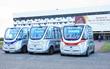 Three members of NAVYA's fleet of driverless electric ARMA shuttles