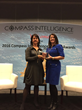 "Carii CEO Denise Hayman-Loa accepts the CES 2016  ""Innovative Application of the Year"" award from Stephanie Atkinson, CEO, Compass Intelligence"