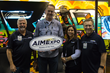 The Bates Footwear Team accepting a booth award at the 2015 AIMExpo.