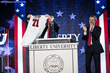 Liberty University President Jerry Falwell presents Donald Trump with a Flames football jersey on Jan. 18, 2016.