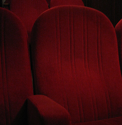 Dinner cinemas offer delicious menu items as patrons watch movies in plush, comfortble seating.